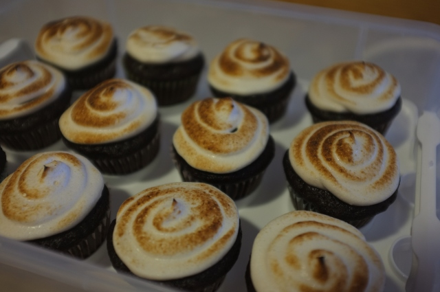 I decided these should be toasted marshmallow cupcakes and used my butane kitchen torch to toast them. I think I made the right choice. :)
