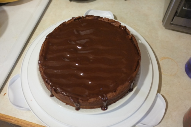"With some classic fresh ganache poured over the top, ""artfully"" dripping down the sides."