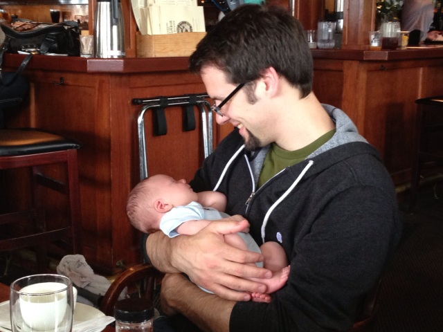 Daddy holding Georgie at Mcmenimans