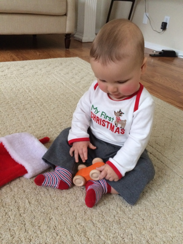 George getting his toy car out of his stocking