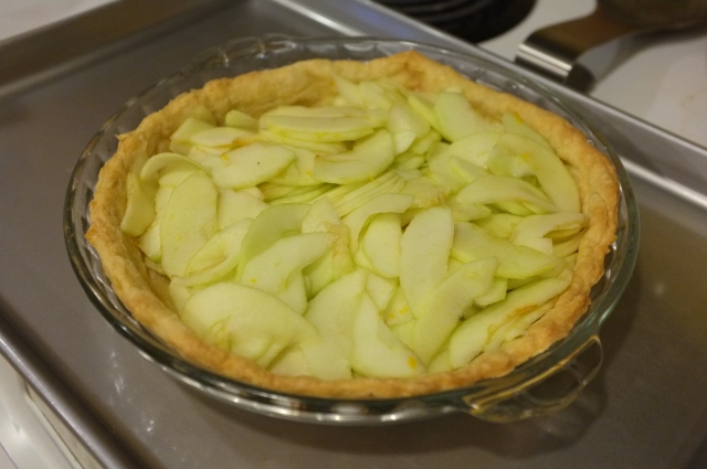 Apples in the pre-baked crust, ready to bake a bit